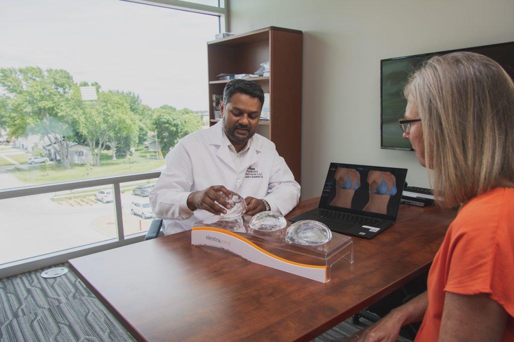 Dr. Mark Shashikant explaining options for breast enhancement.