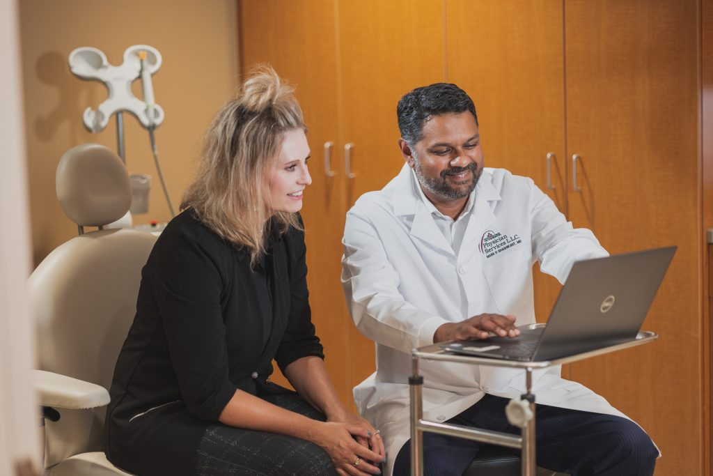 Dr. Mark Shashikant consulting with a plastic and reconstructive surgery patient.