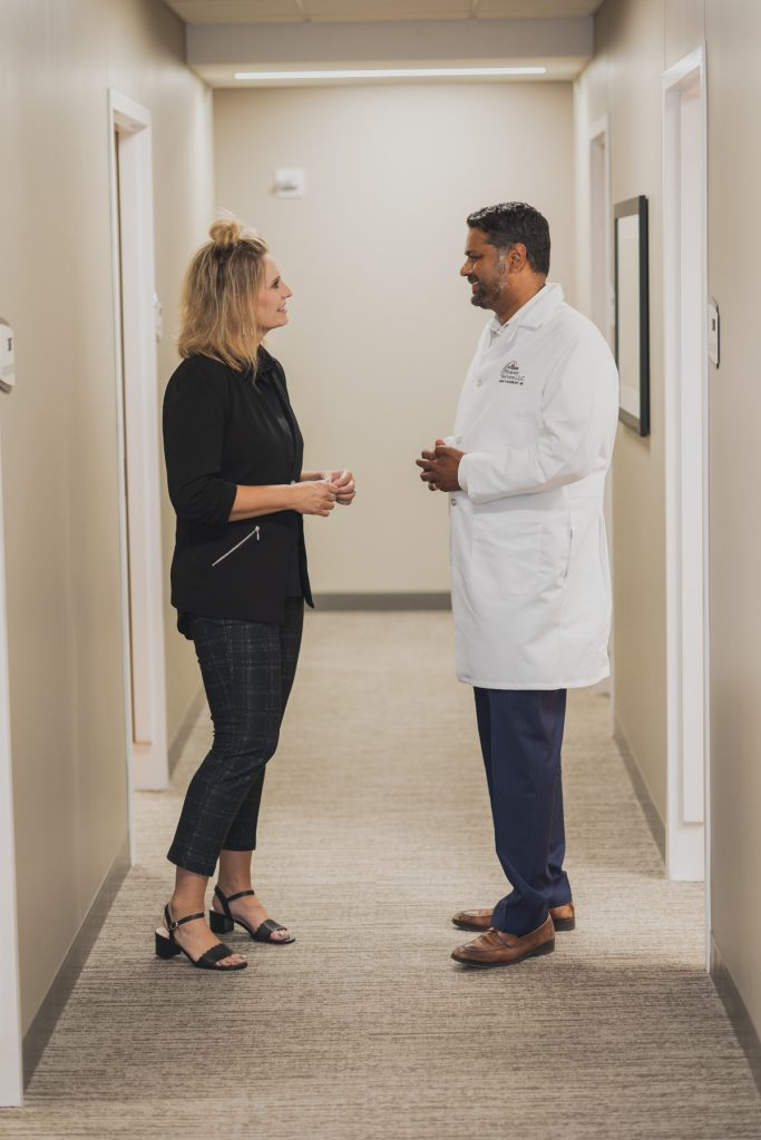 Dr. Mark Shashikant talking with a patient.