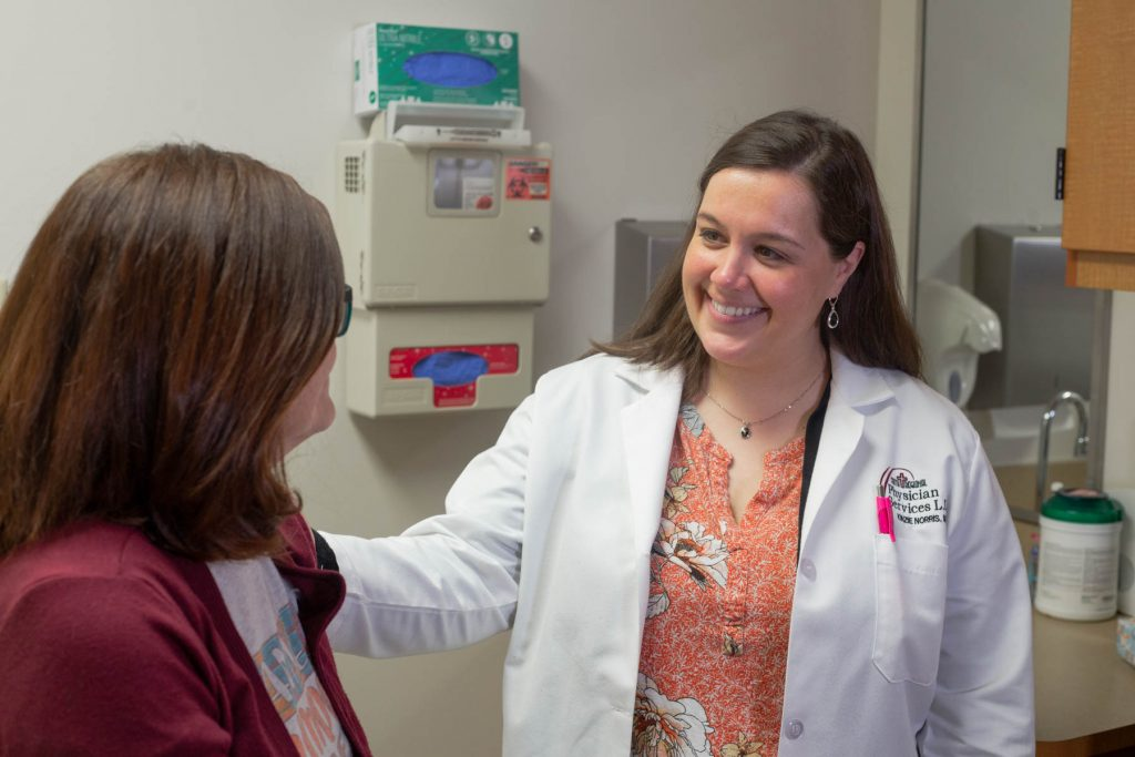 Dr. Kenzie Norris talks with a patient at Faith Regional Physician Services Breast Care in Norfolk.