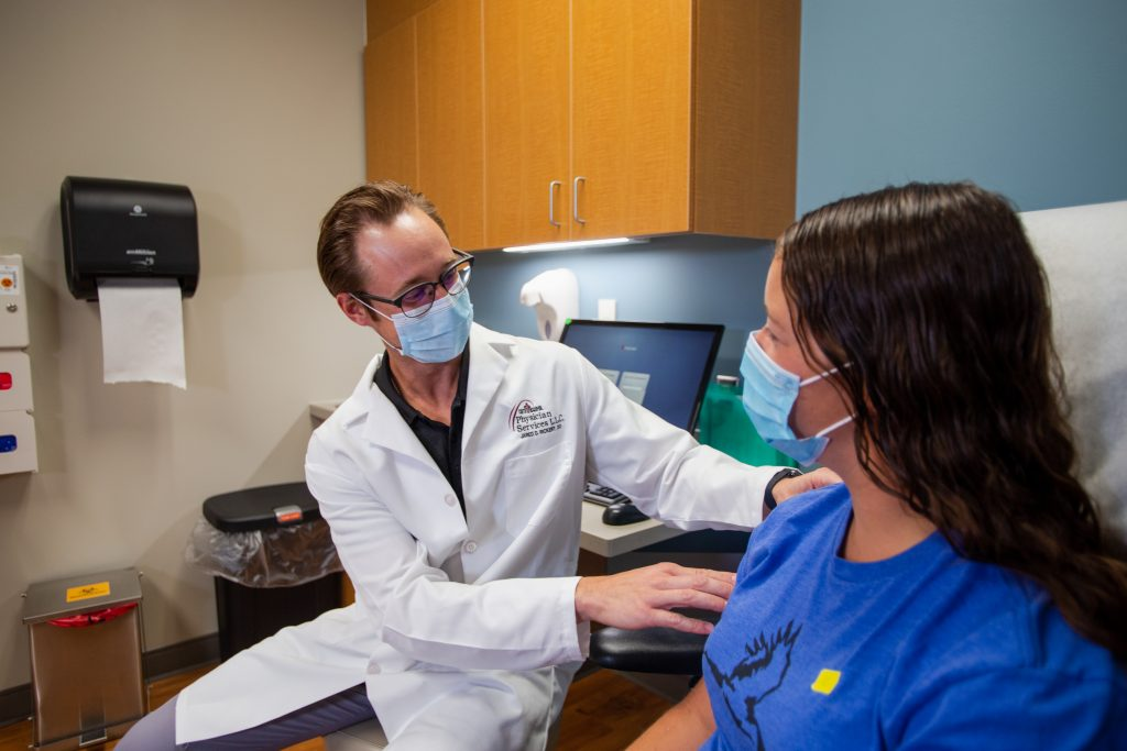 Dr. Jared Rickert examines a patient at Faith Regional Physician Services Orthopedics in Norfolk.