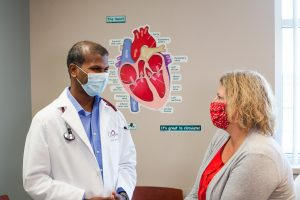 Cardiologist with heart patient
