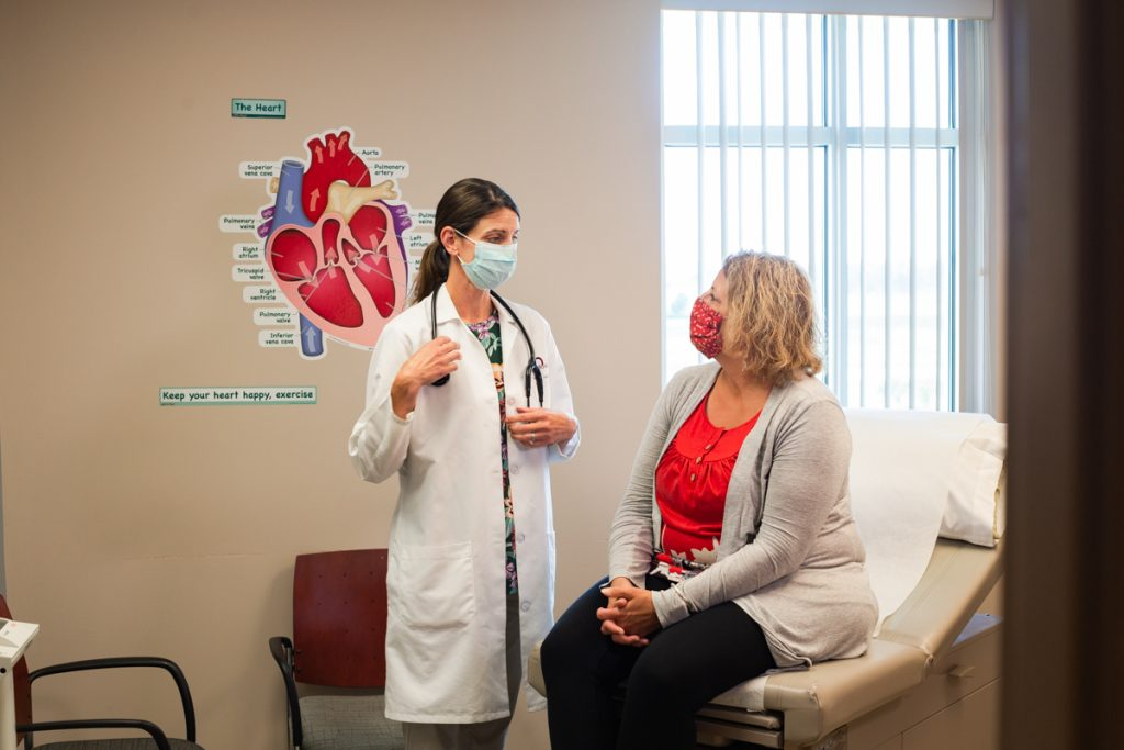 Dr. Maryanne Hartzell talks with a patient at Faith Regional CardioVascular Institute in Norfolk.